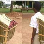 Young boy uses a school bag made from palm fronds to school