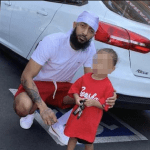 Last Photo Of Rapper Nipsey Hussle Posing With A Fan's Child Just Moments Before He Was murdered