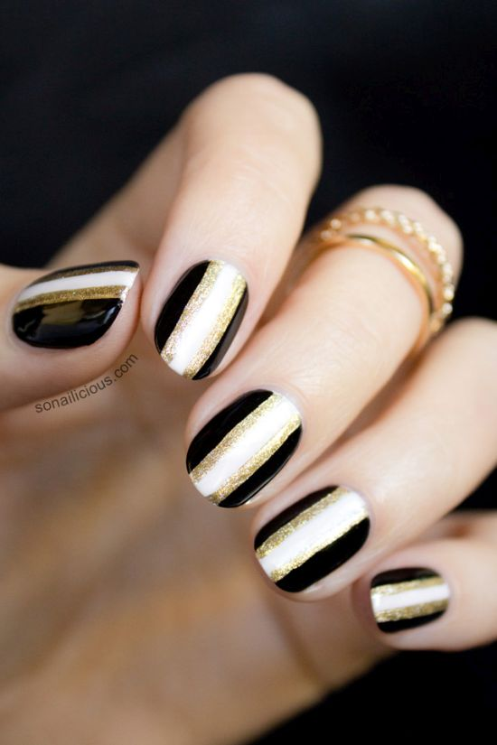 Party Perfect Black And Gold Nails With Stripes