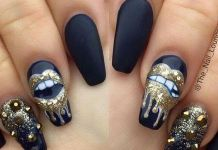 Black Nails With Gold Lips And Studs
