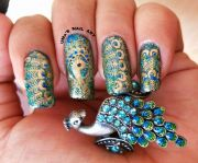 gorgeous peacock nail design