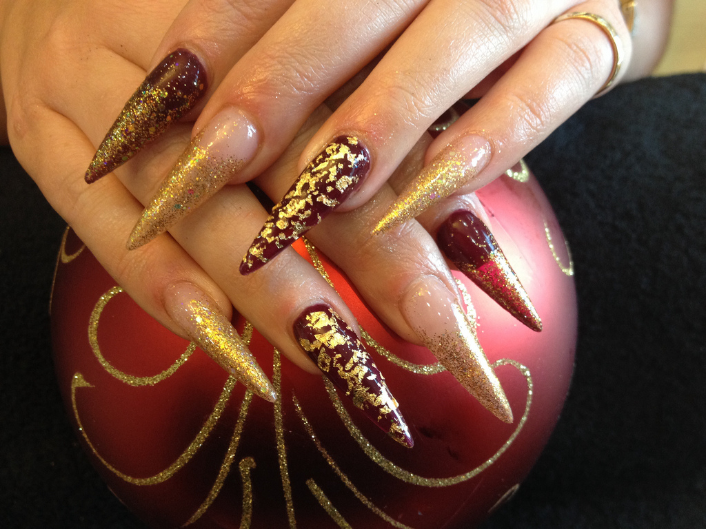 Sti Nails With Gold Glitter And Foil Over Deep Red Gel Polish