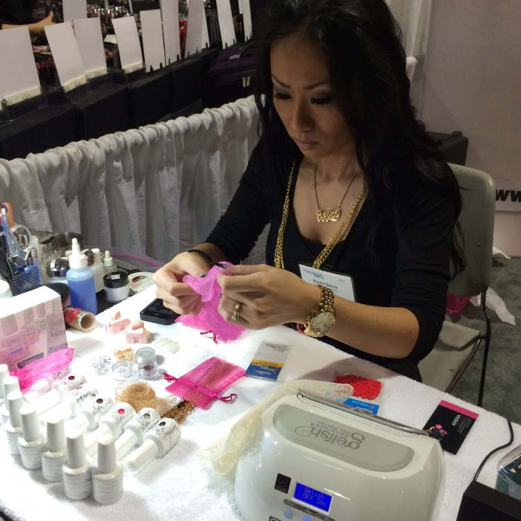 Ryoko inspecting her Gelish colors and craft store items