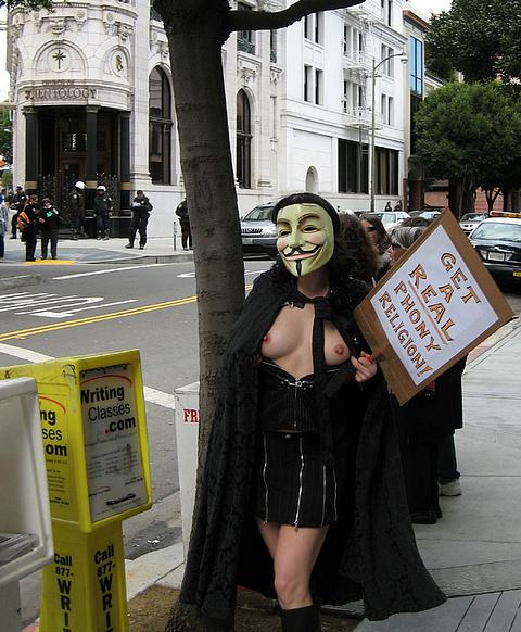 naked woman protesting against Scientology