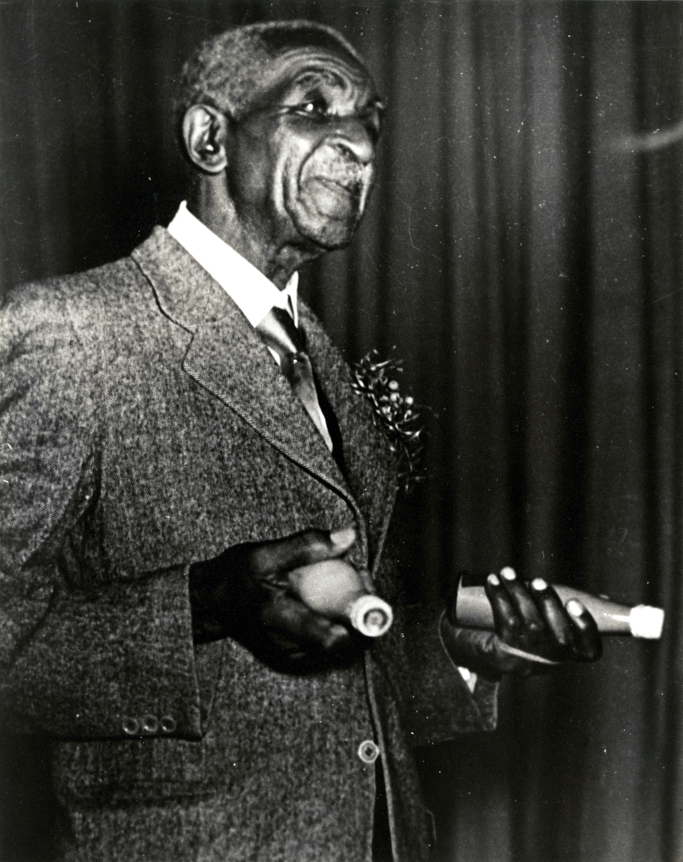 Photo Of George Washington Carver With A Bottle In Each