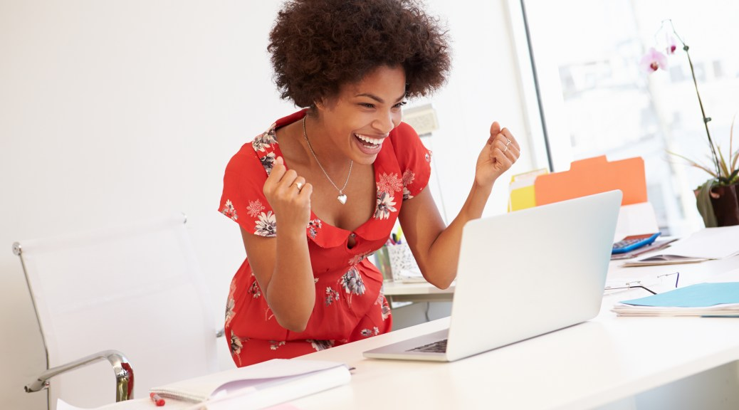 Excited Woman Working at computer
