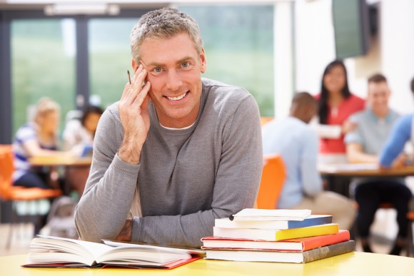 man in classroom with books