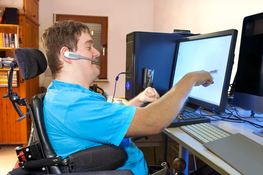 Man with infantile cerebral palsy using a computer