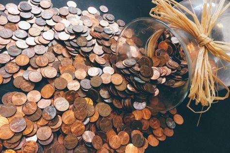 jar spilling out coins