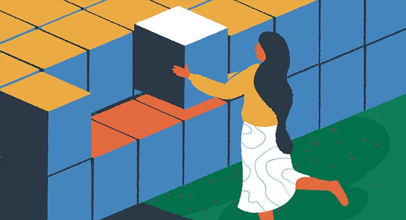 woman stacking blocks