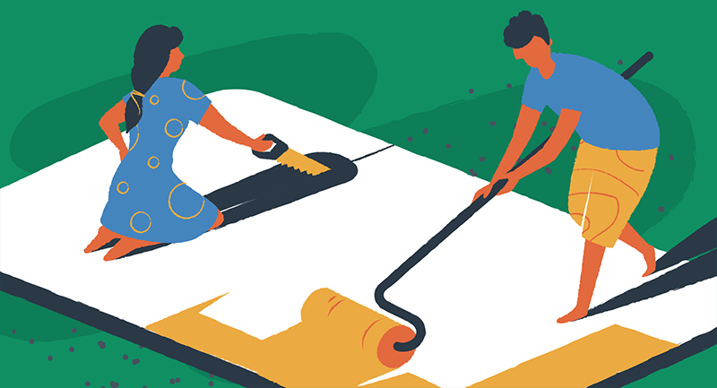 man and woman designing a website with a saw and paint