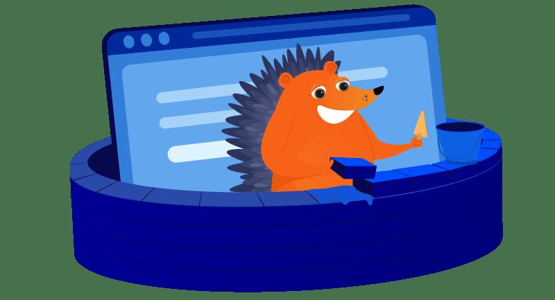 hedgehog building a brick wall around his laptop