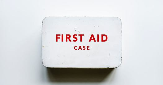 White First Aid Case Mounted on a White Wall