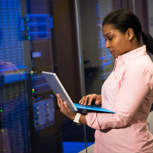 Woman with Laptop Checking on Storage Server