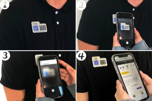 Man wearing a QR code accessible name tag that is being scanned
