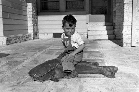 little boy, large catfish, old photo, texas, 1940s