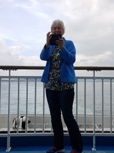 Nancy on the back of a ferry taking a photo