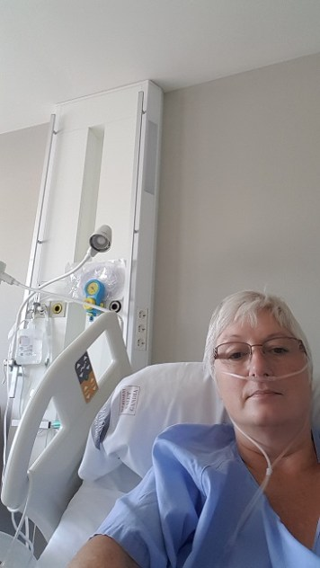 Nancy in a hopital bed on oxygen