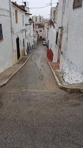 Narrow street in a white Spanish town