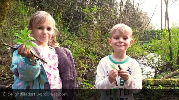 siblings making nature boats