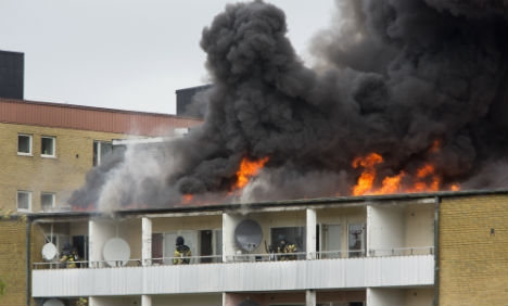 The blaze which broke out in an apartment block in Rosengård on May 10th 2014. Photo: Drago Prvulovic/TT