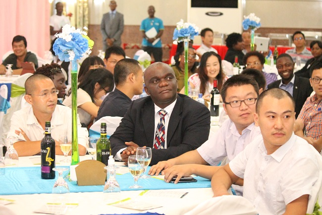 Ecobank Liberia board member Dorbor Jallah ( coat and tie) and some members of the Chinese business community