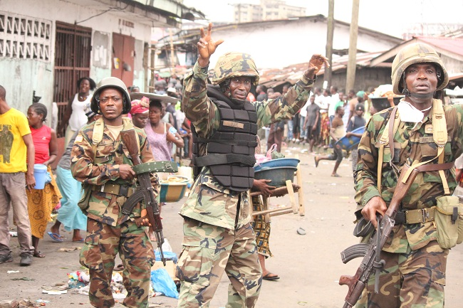 Liberian government soldiers in slum communtiy of West Point