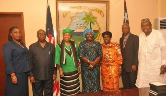 President Sirleaf (3rd from left) poses with members of the CRC