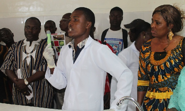 A Student demonstrates the laboratory equipment during the inauguration of the science lab at Grand Bassa Community College.
