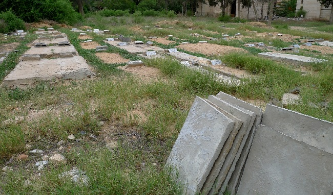 Migrant graves in the Tripoli Christian cemetery. All have a headstone bearing the date of burial and reference number so they can be traced back to the DNA database. (Photo: Tom Westcott/IRIN)