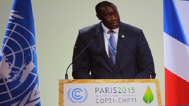 Liberia's Finance and Development Planning Minister Amara Konneh speaks at the climate change conference in Paris