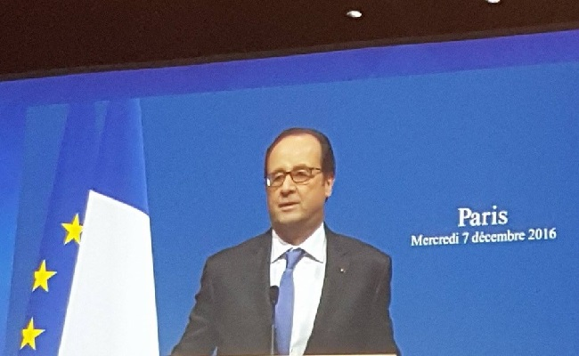On screen: President Hollande speaks during the opening ceremony