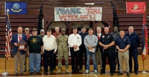 Veterans stand at Middle School program