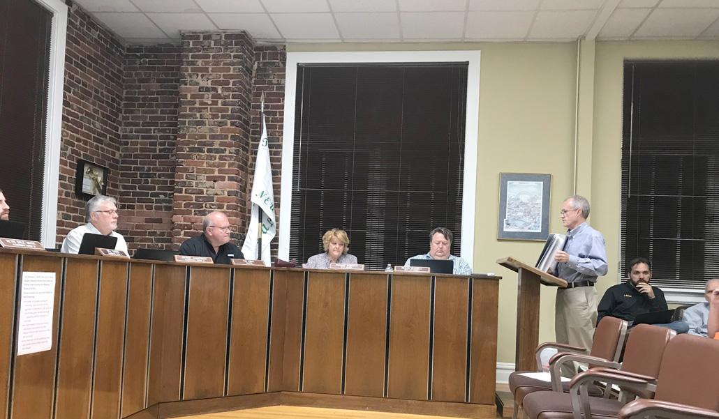 City planner addresses board
