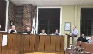 City planner addresses board