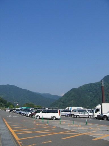 Dangozaka service area car park with a beautiful blue sky.