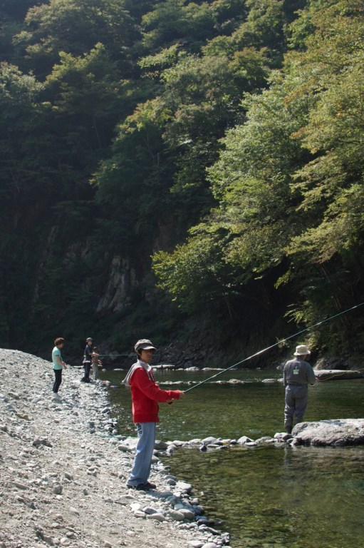 People fishing in a stocked river section