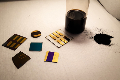 a sample of pulverized coal (right) is shown with several test devices made from coal
