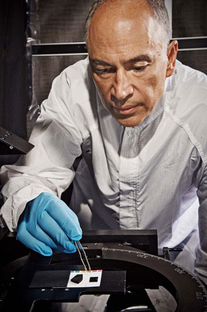 Optics engineer John Hagopian works with a nanotube material sample