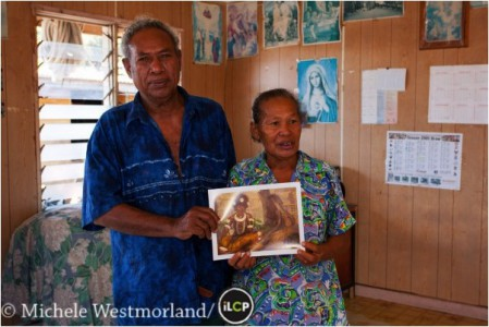 "The grandson, Oala Mase, of Kori Taboro in the painting ""For the Dance"" by Caroline Mytinger. Oala's wife is pictured with him holding the print of the painting."