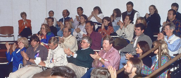 Some of the attendees at the Photography Forum, Jamestown Community College, Jamestown, NY. October 1-3, 1993. Visible in photo: Virginia Peterson, Carl Sams, George Lepp, Towny Dickinson, John Nuhn, Frans Lanting, Helen Gilks, Helen Longest-Slaughter (partially hidden behind railing), Tom Mangelsen, Phyllis Greenberg. Renowned photographer, artist and ornithologist Roger Tory Peterson and the Roger Tory Peterson Institute organized this meeting, the first time in the U.S. that nature and conservation photographers, editors, agents and enthusiasts had gathered to discuss the future of the nature photography industry. At the meeting's close, Frans Lanting passionately asked that the interest and enthusiasm not end here. There was a consensus that the field needed some type of organization to represent its interests and promote communication and education. A core of attendees interested in forming an association met informally in the college library to set up plans. Two important tenets were established at that afternoon meeting: that the new association would be for nature photography, not restricted to photographers, and that it would represent all of North America, not just the United States. Several names for the new association were considered. RTPI volunteers to handle donations to assist in the formation of the association and the