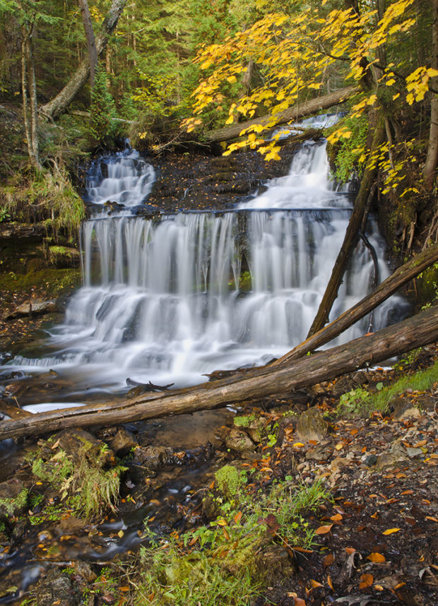 Wagner Falls flows in autumn at Wagner Falls State Scenic Area in Alger County near Munising in Michigan's Upper Peninsula. © Hank Erdmann
