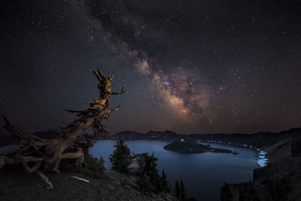 "Showcase 2018 Top 100 winner: ""Milky Way over Crater Lake, Crater Lake National Park"" © Chuck Haney"