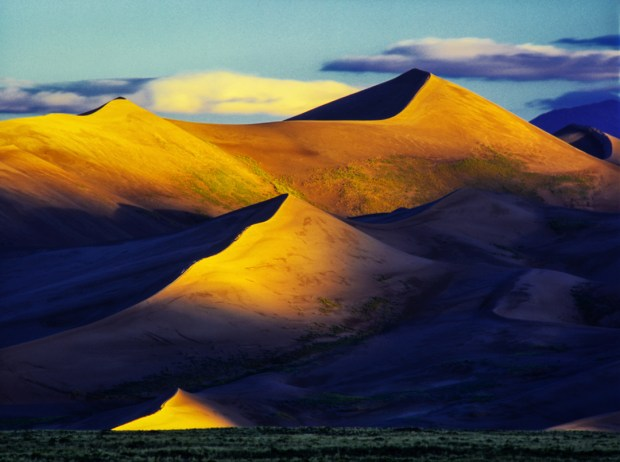After crossing the small Medano Creek bed, the Great Sand Dunes loom before you. Sunrise is the best time to capture the contrasts that make dune photographs dramatic and successful.