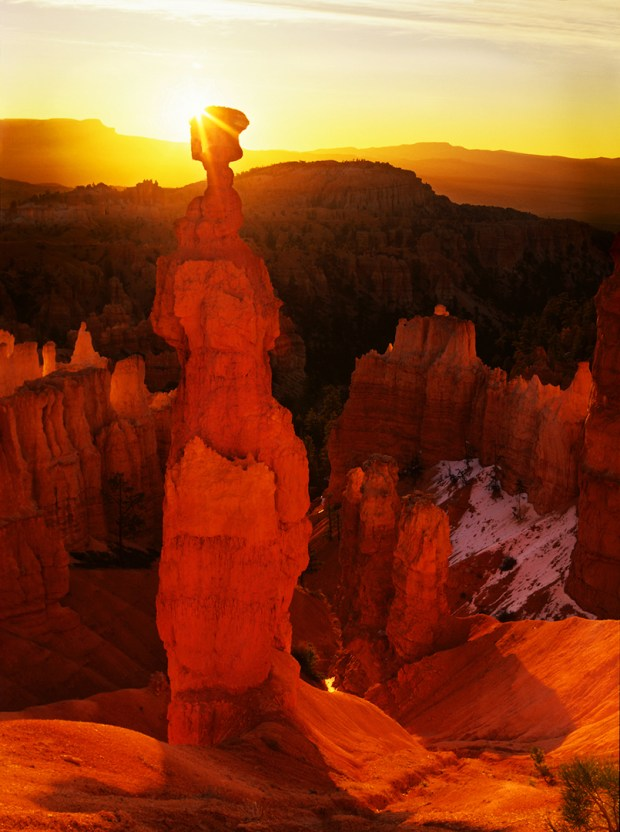 One of the most stunning hoodoos anywhere, the ochre colored pinnacle dubbed Thor's Hammer rises high above Sunset Point in Bryce Canyon National Park.