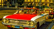 Antique and historic American cars are common sights in Central Havana, Cuba. 1960 Chevrolet Impala convertible.