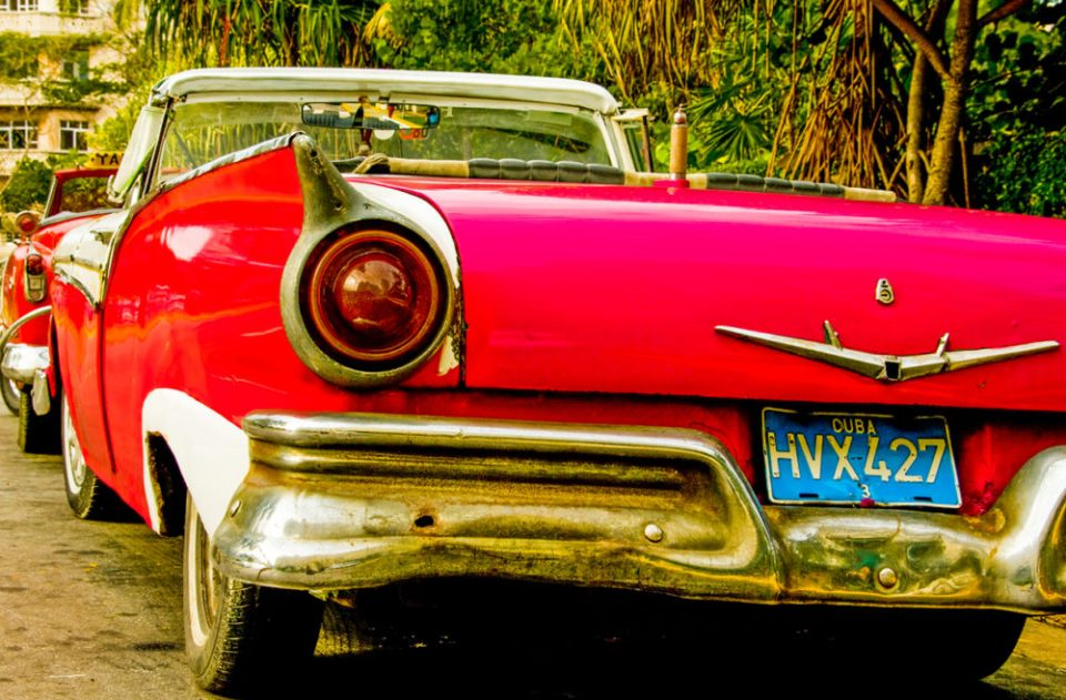 Historic American cars, many serving as taxis, create a time warp as they roam the streets of Havana, Habana, Cuba. 1957 Ford convertible.
