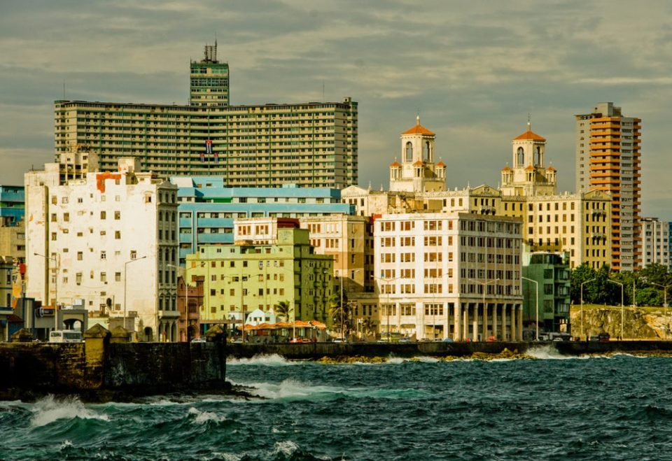 Vedado ocean front and the twin towers of the iconic Hotel Nacional seen from the Malecon ocean drive, Havana, Cuba.