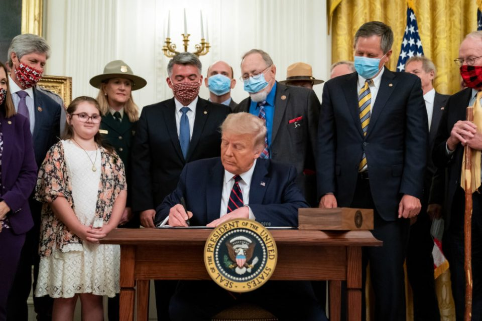 President Donald J. Trump signs H.R. 1957- The Great American Outdoors Act Tuesday, August 4, 2020, in the East Room of the White House. (Official White House Photo by Tia Dufour) Public Domain