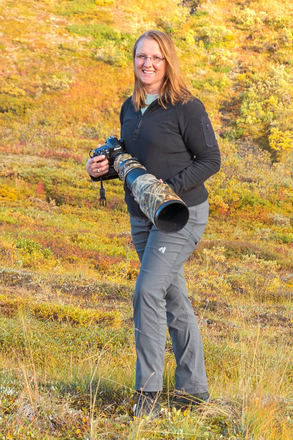 Dawn Wilson photographing wildlife on the tundra of Denali National Park and Preserve, Alaska.